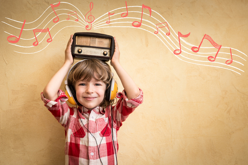boy-listen-music-with-radio